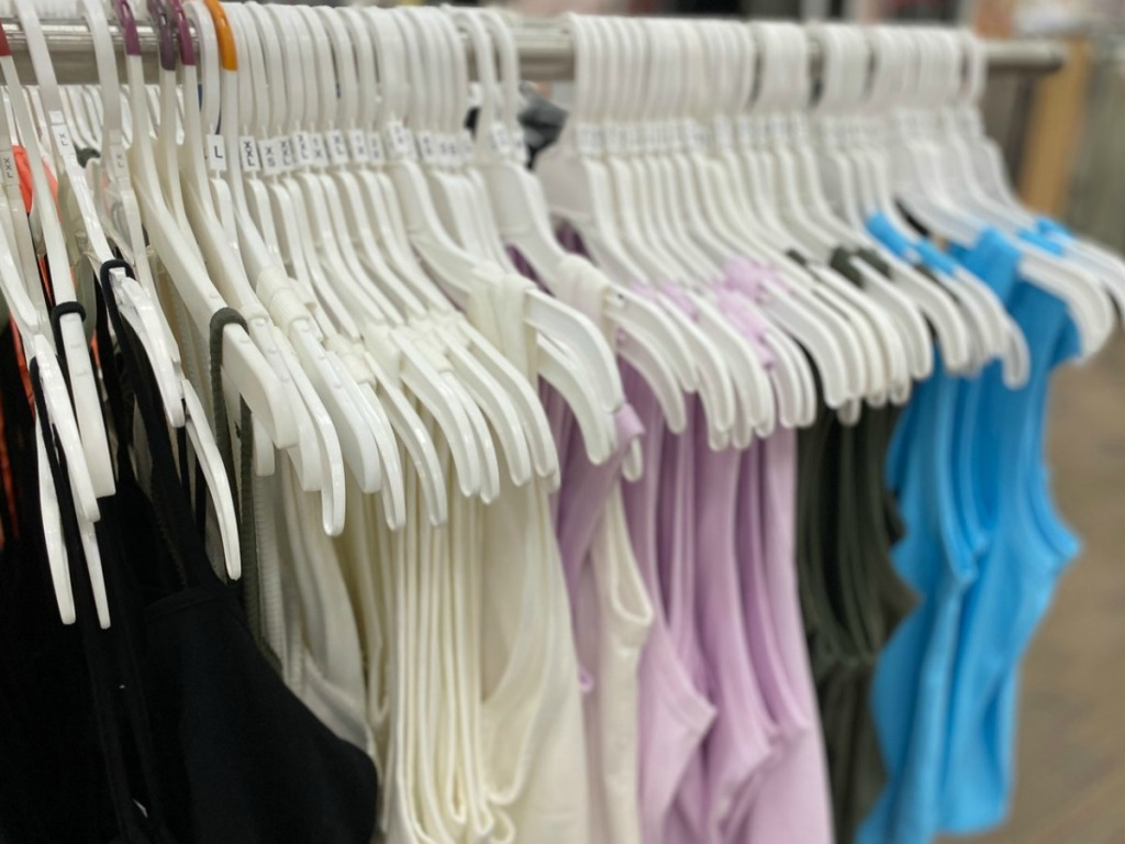 tank tops on hangers in store