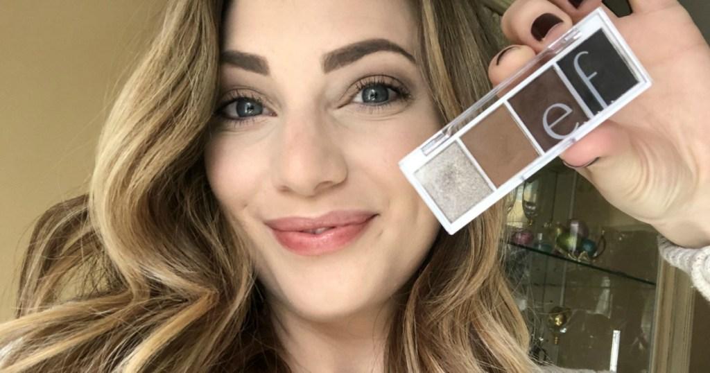 woman holding elf cosmetics eyeshadow pallete