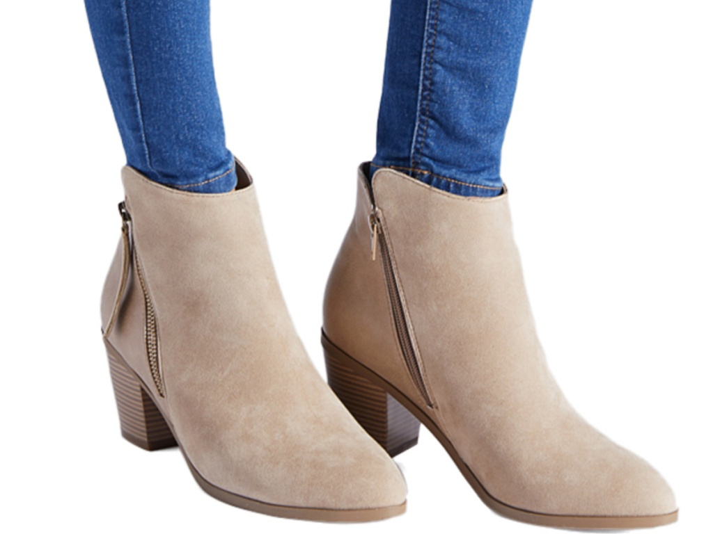 women's legs wearing taupe booties with side zip