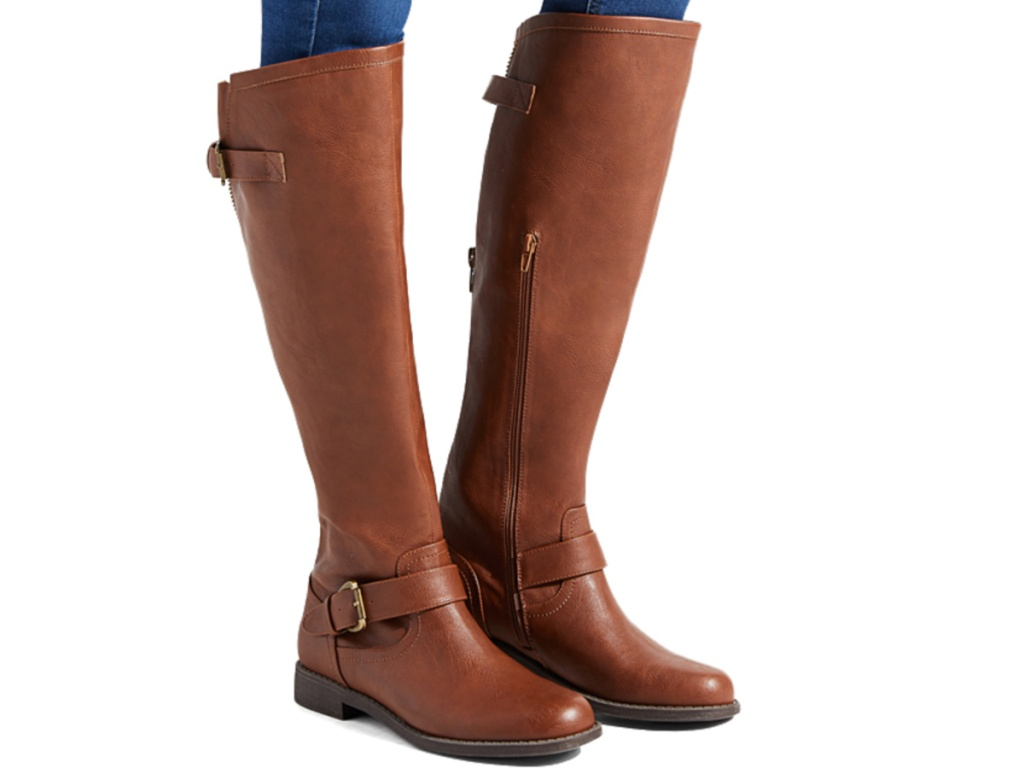 women's legs wearing tall brown riding boots with buckle on side