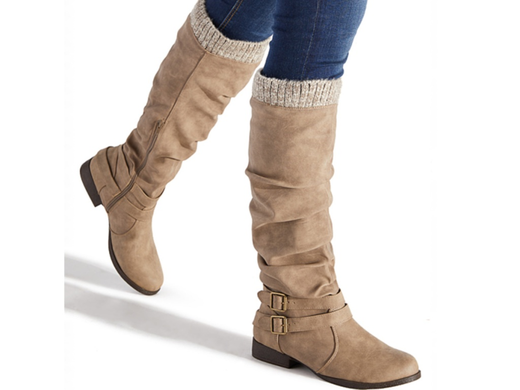 women's legs wearing tan tall boots with sweater upper and two small side buckles