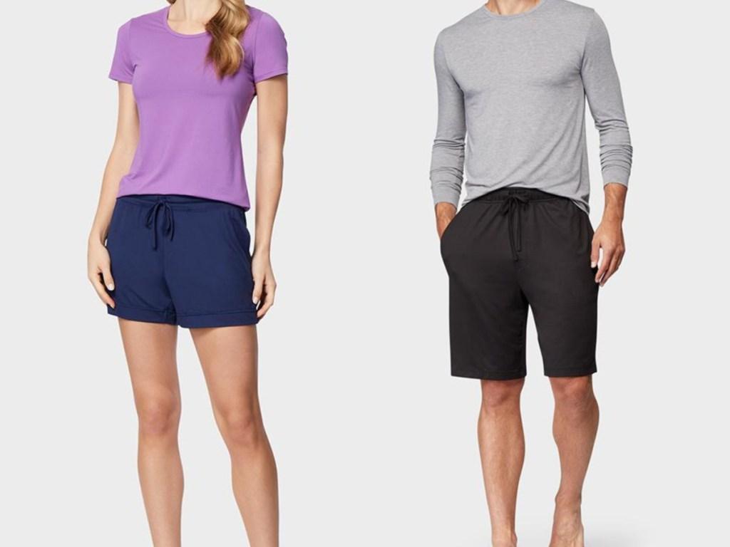 woman wearing blue shorts, man wearing black shorts