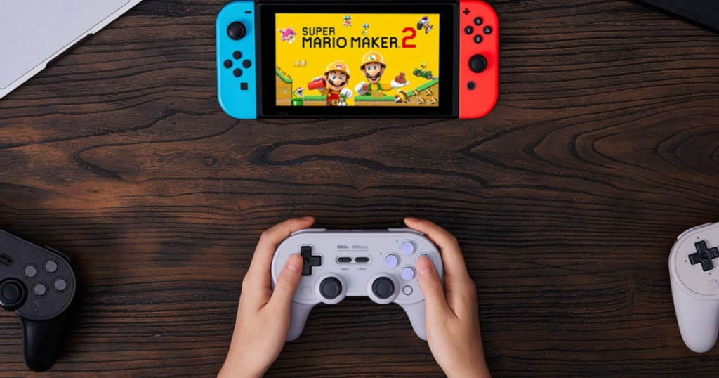 hand holding 8BitDo - SN30 Pro+ Wireless Controller playing mario maker 2 on nintendo switch