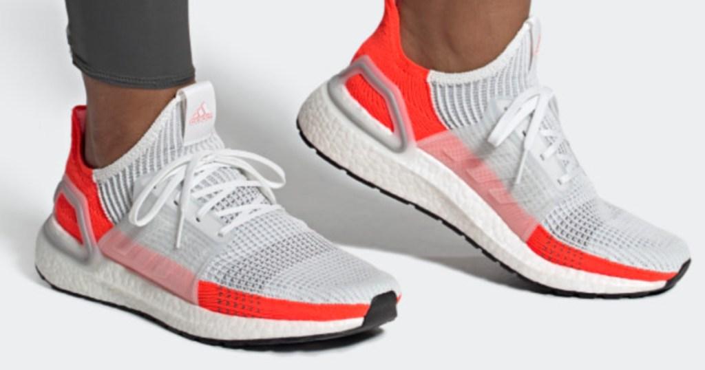man wearing adidas ultraboost running shoes