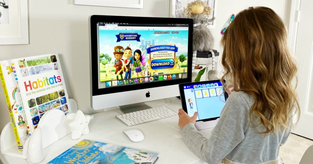 Girl playing Adventure Academy on computer