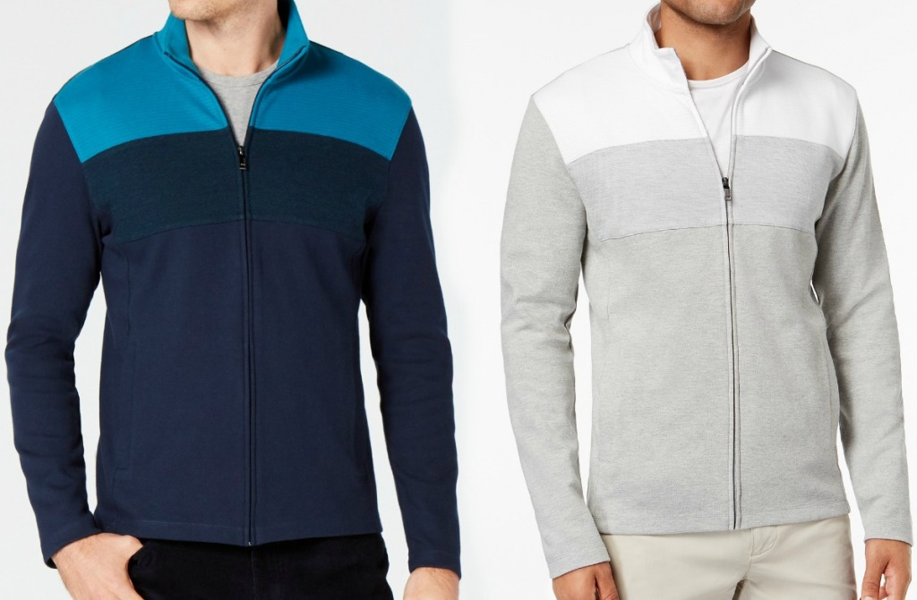 Two men wearing a color block zip up pullover