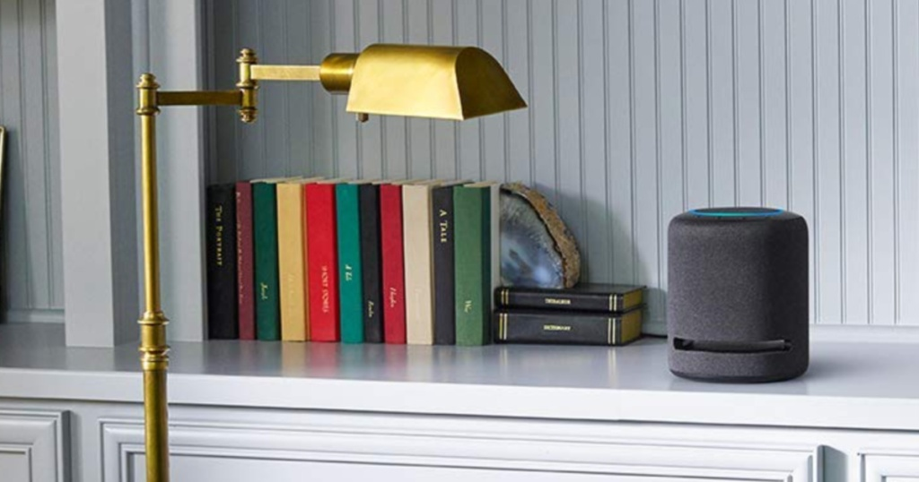 amazon echo studio in office on white counter with books and lights