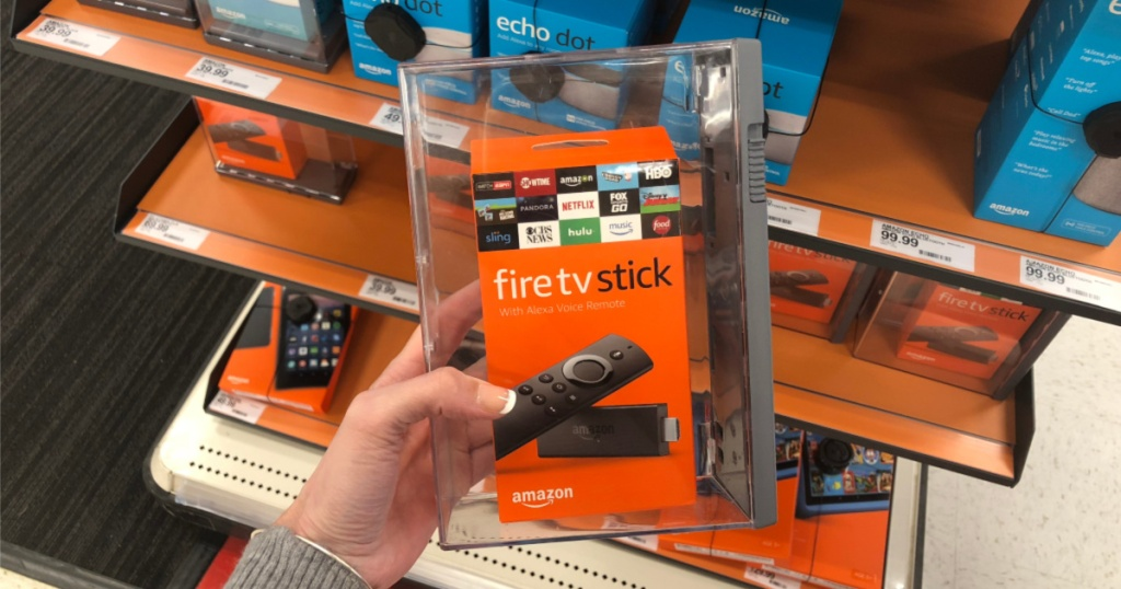 woman's hand holding streaming tv stick in store