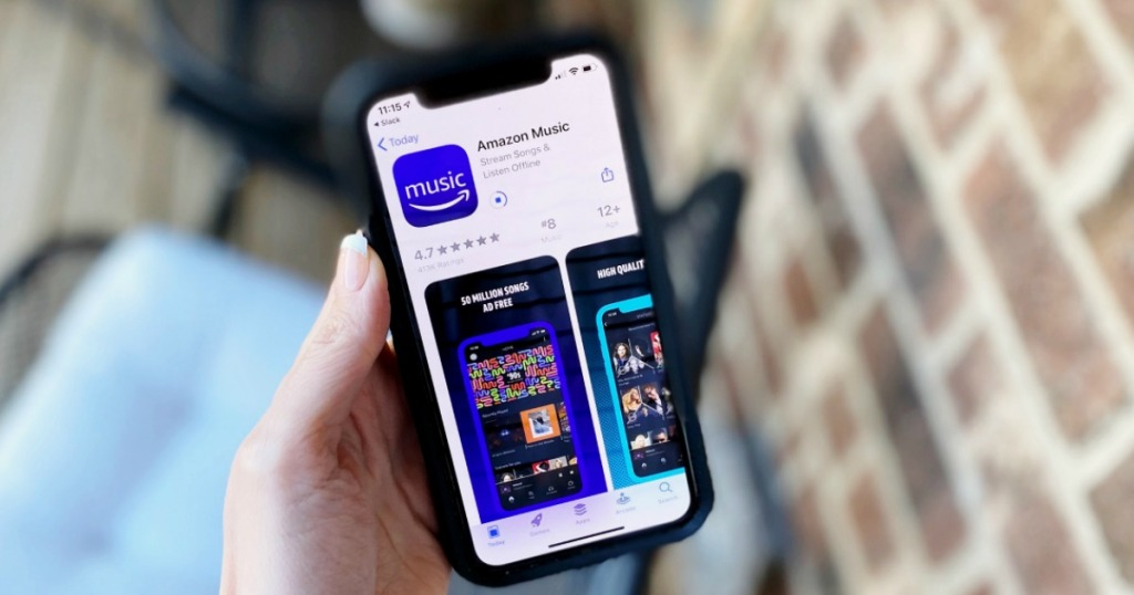 hand holding a phone showing the Amazon Music app