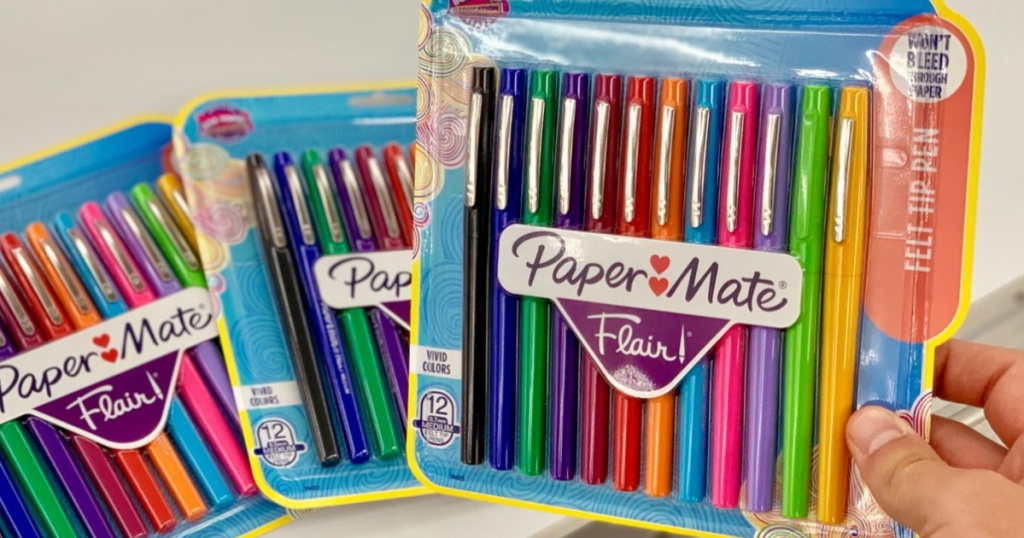 Hand holding Paper Mate Flair Pens