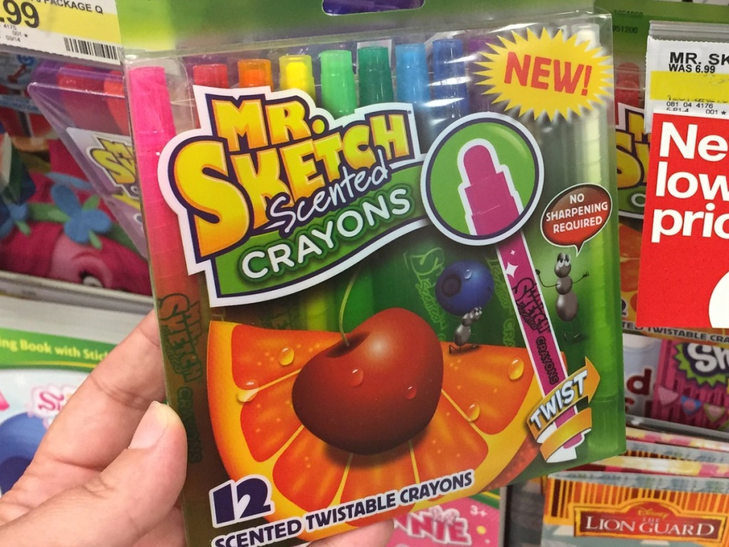 Hand holding Mr. Sketch Scented Crayons