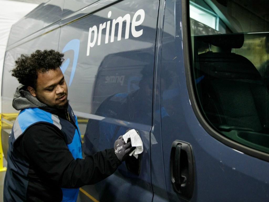 Worker cleaning Amazon Prime Van