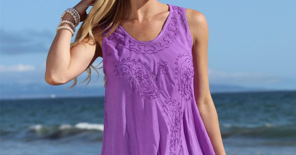 woman on beach in purple dress