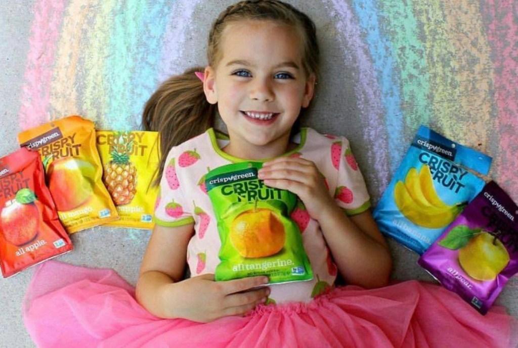 girl holding snacks