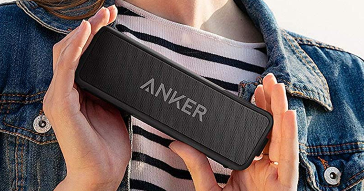 Woman holding Anker Wireless Speaker