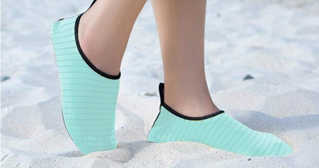 Woman wearing Aqua water Shoes on beach
