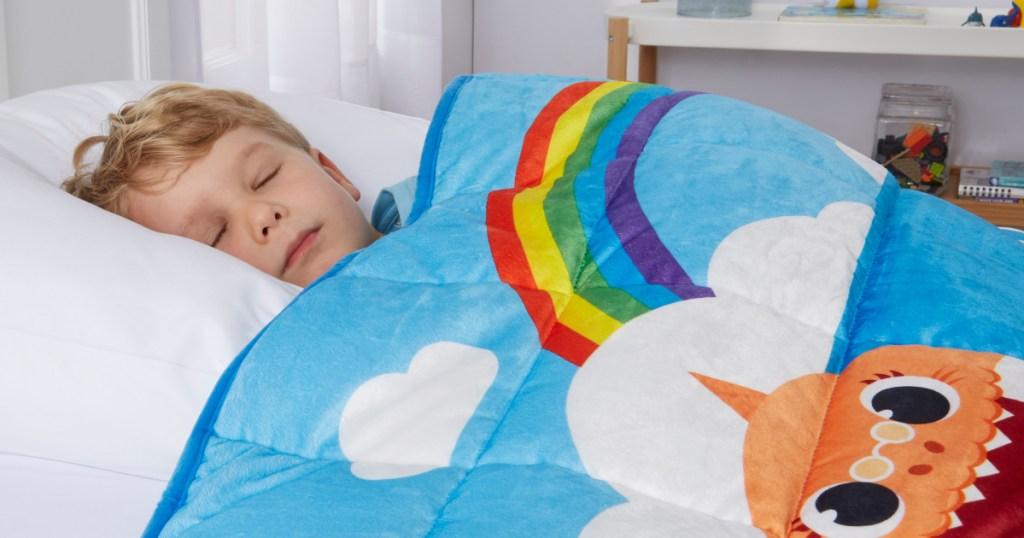 Little boy sleeping under baby shark weighted blanket