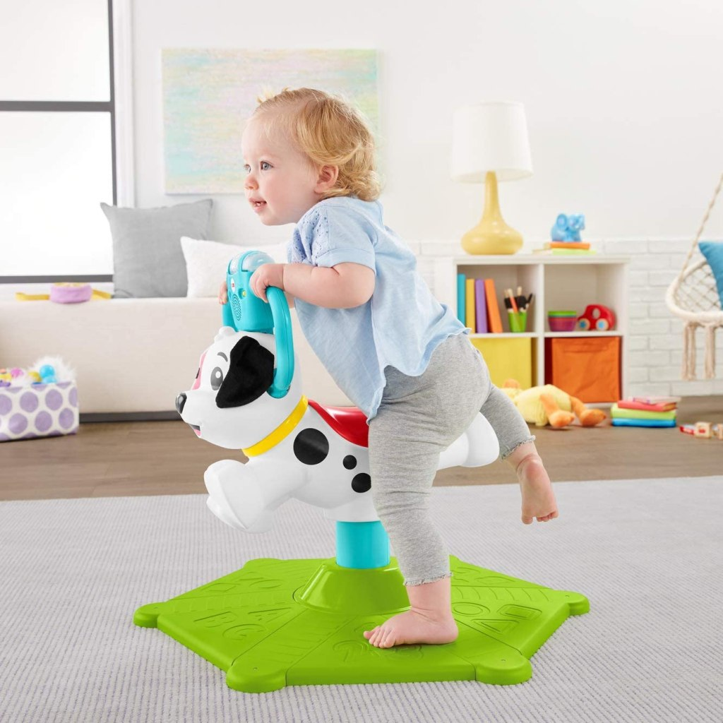 Baby climbing on Fisher Price Bounce Puppy