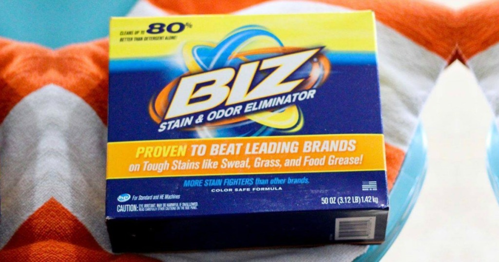 Box of Biz Laundry Detergent Powder Booster, Stain & Odor Removal on top of towels