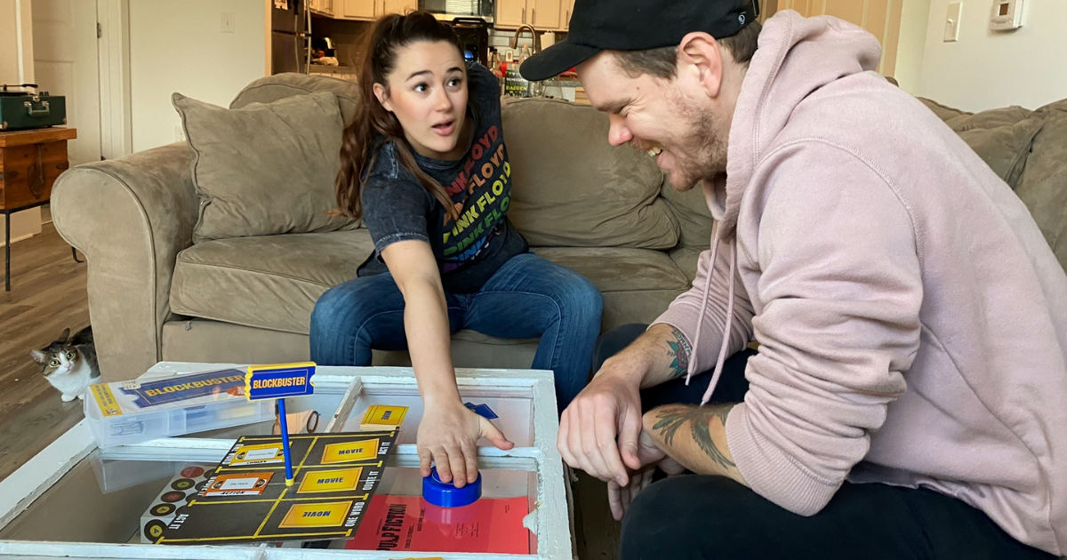 Man and woman playing Blockbuster game in living room