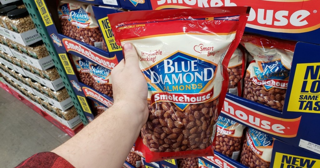 hand holding large Blue Diamond Smokehouse Almonds in store