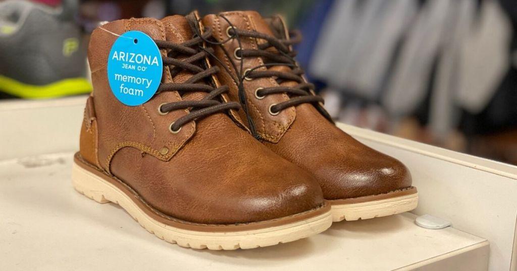 boys leather boots on shelf