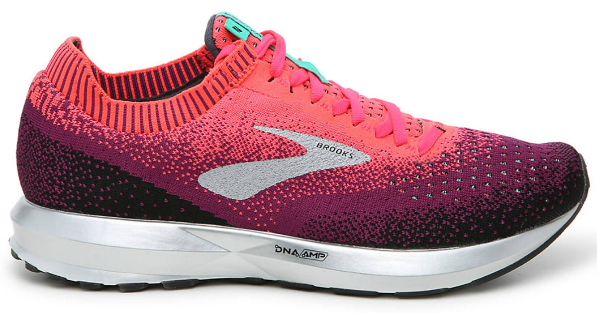 Hot pink women's running shoe with white sole and Brooks logo