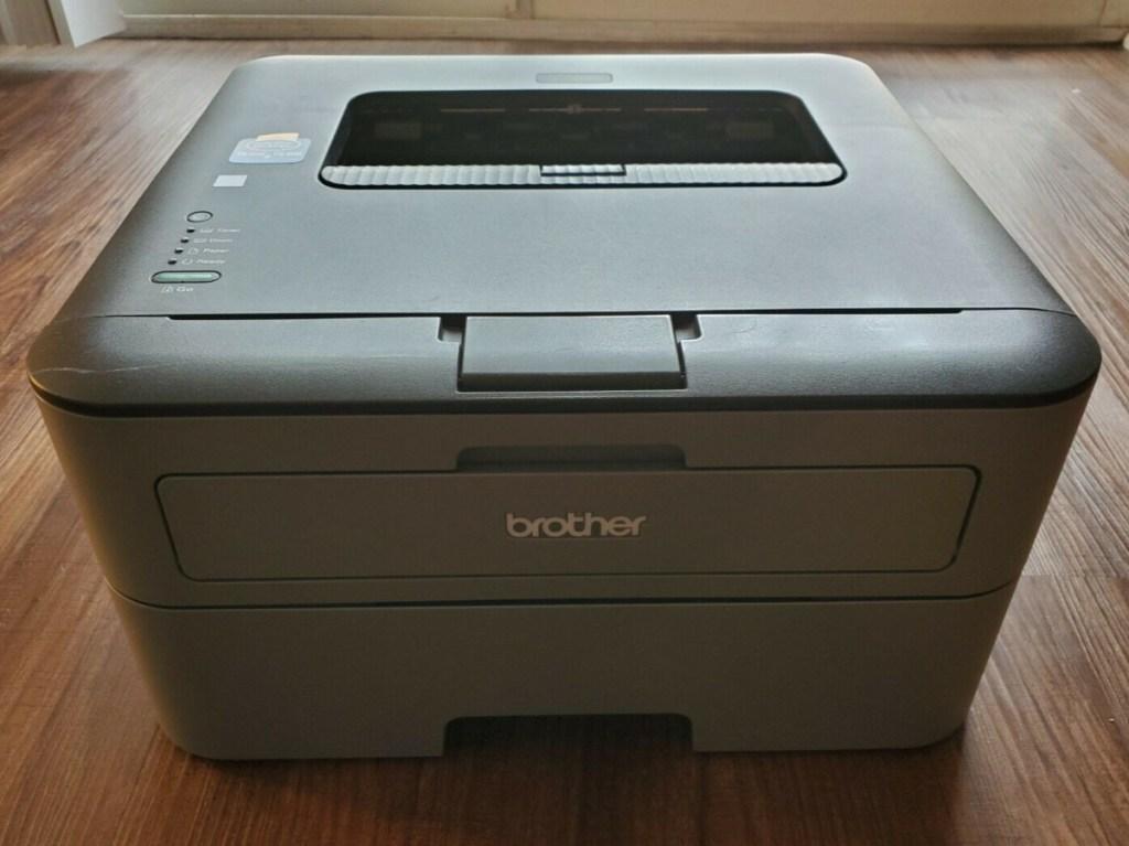 large black printer on wood table