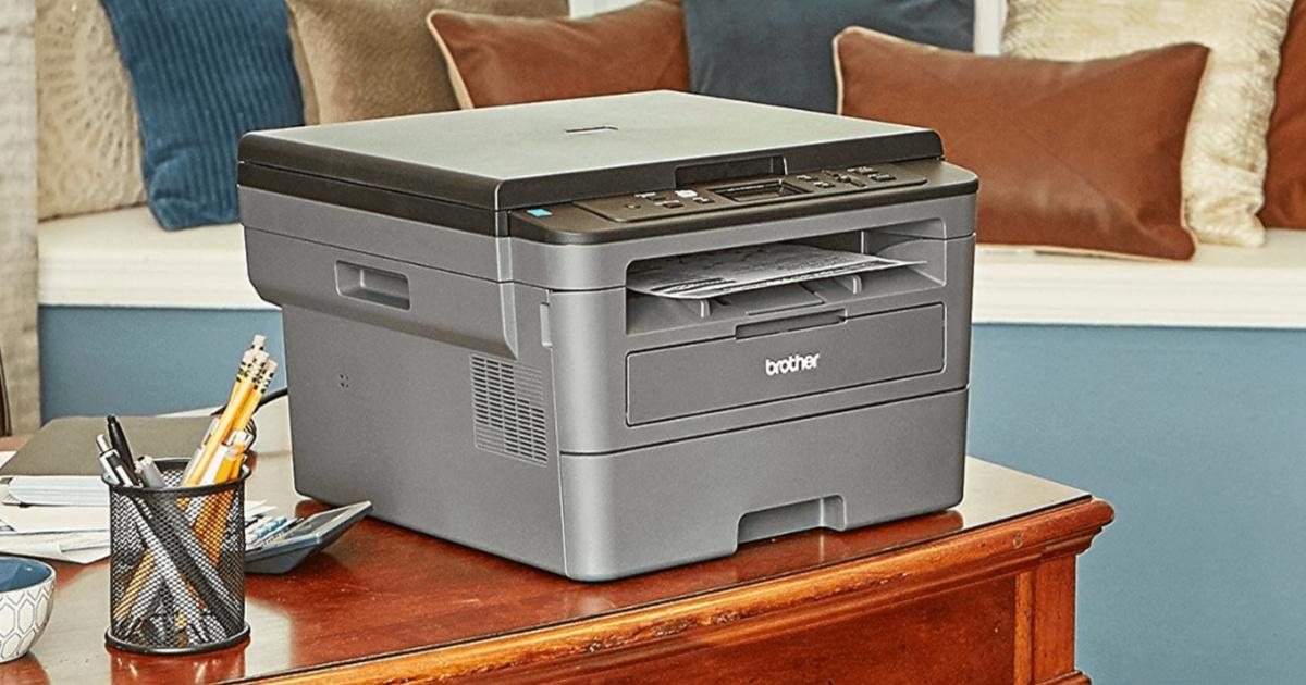 large black printer on desk in home office