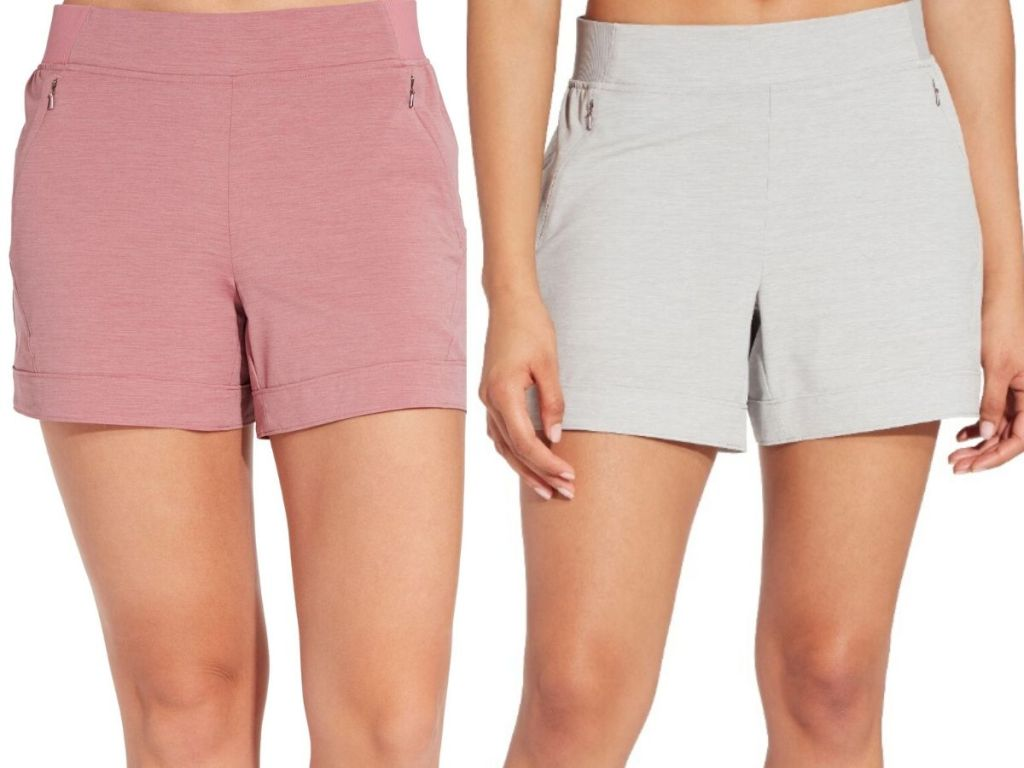 two womens lower bodies wearing shorts