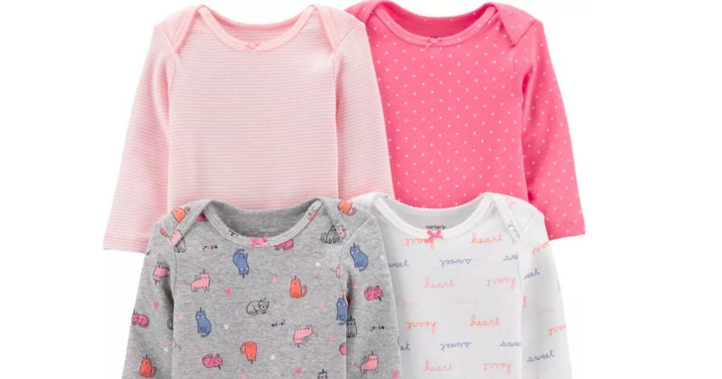 four Carter's bodysuits
