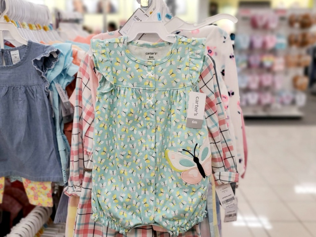 Girls butterfly themed romper on hanger in-store
