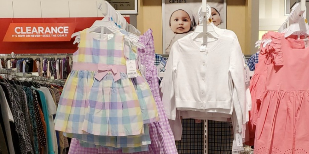 Carter's toddler girls apparel on hangers on display in store