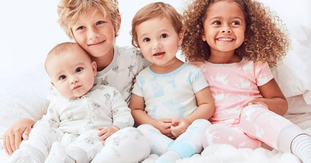 kids sitting together wearing pajamas