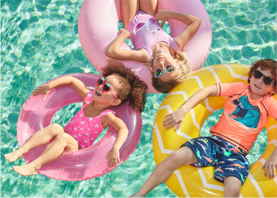 kids floating in tubes in a pool