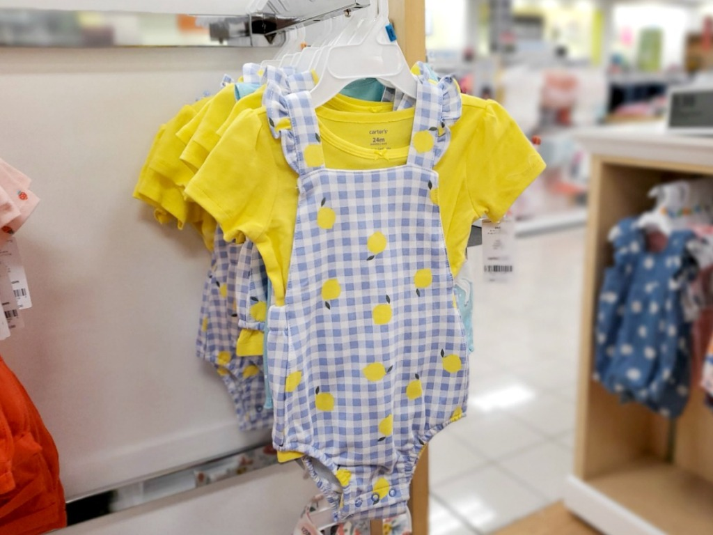 Baby girls outfit with lemons printed on hanger