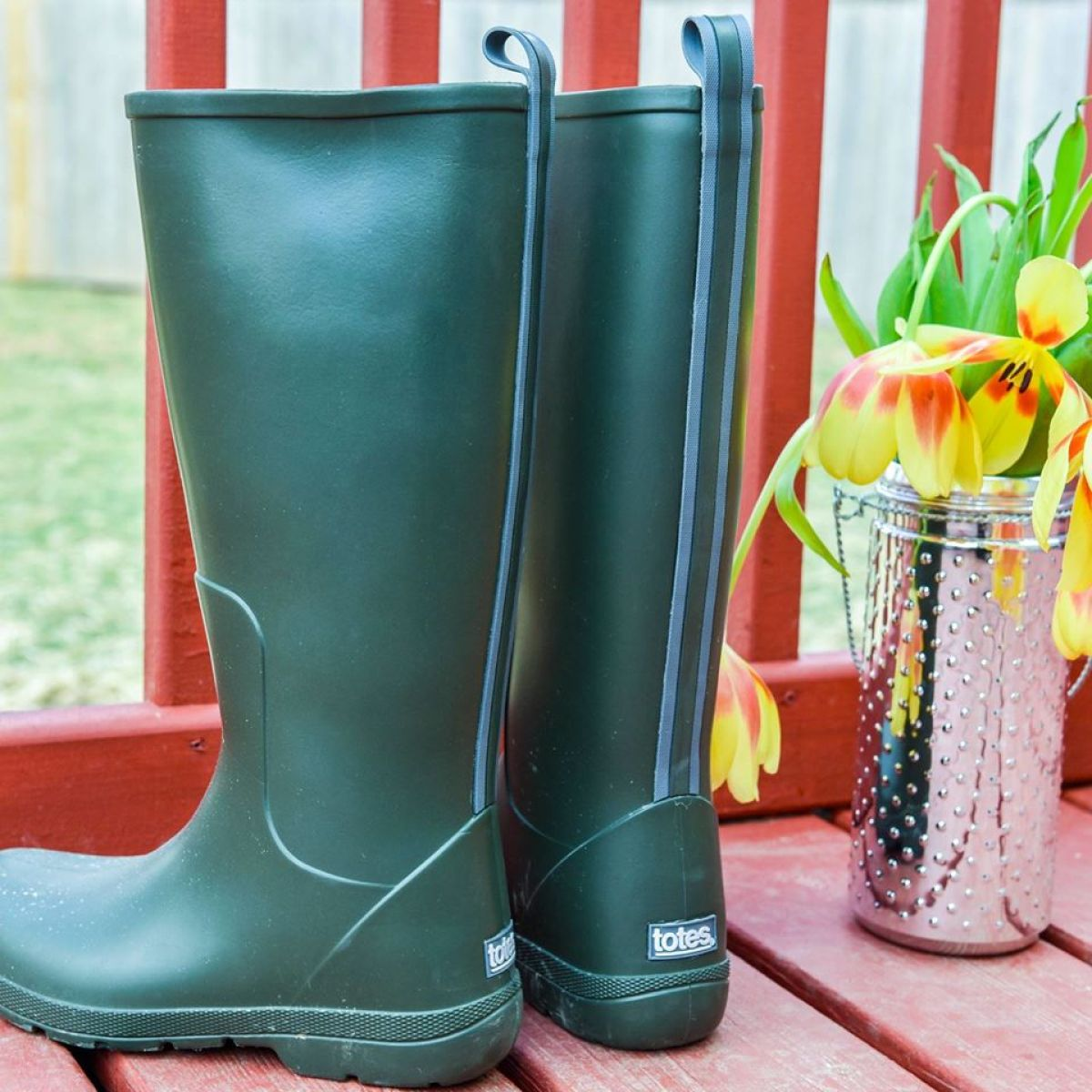 Cirrus Claire Rain Boots placed next to garden tools
