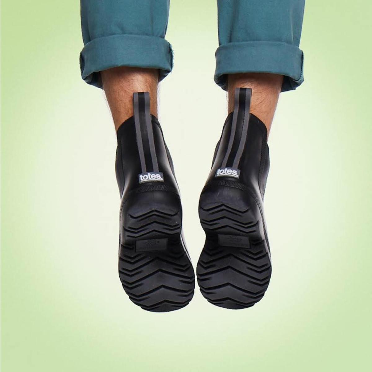 Cirrus men's Tote Rainboots shown on man dangling his feet