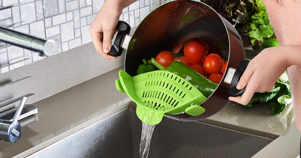 straining veggies over sink with Zulay Kitchen clip-on strainer