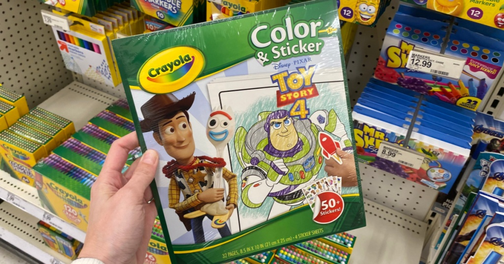 Hand holding Crayola Color & Sticker Book at Target