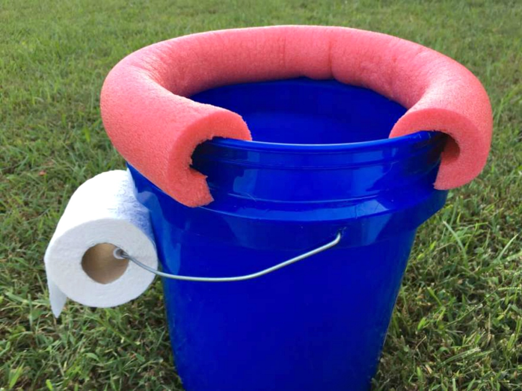 blue bucket with toilet paper