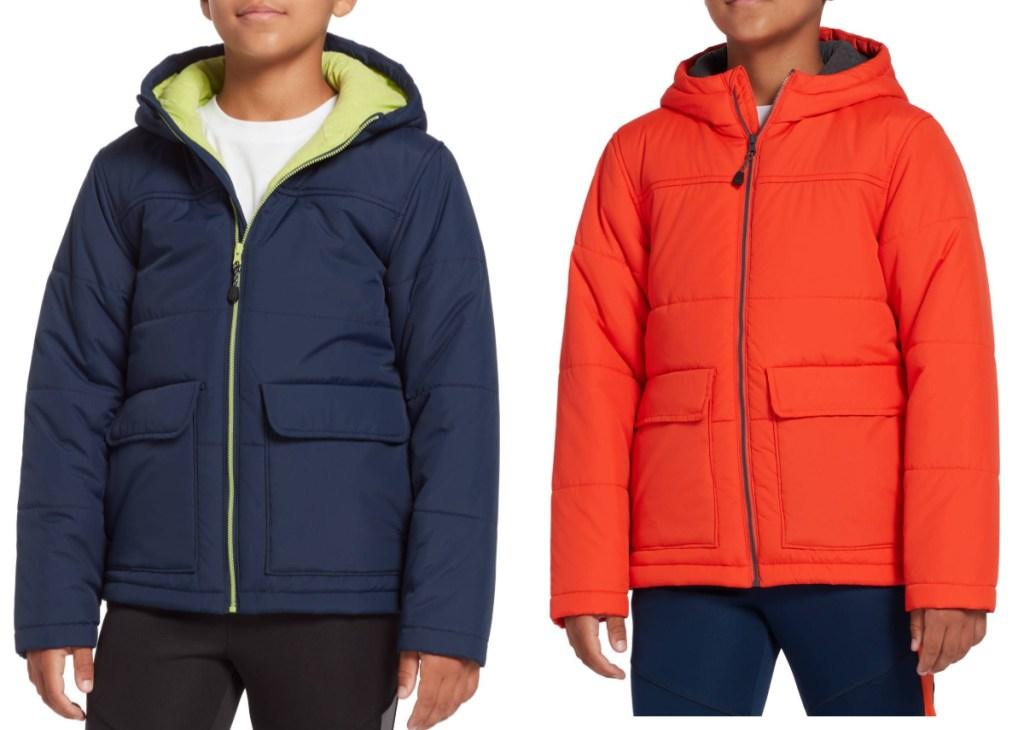 boys wearing blue and orange jackets