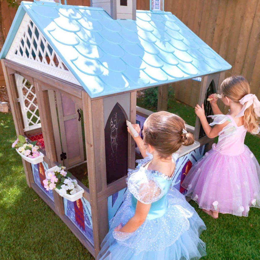two girls using chalk on Disney's Frozen 2 Arendelle Playhouse