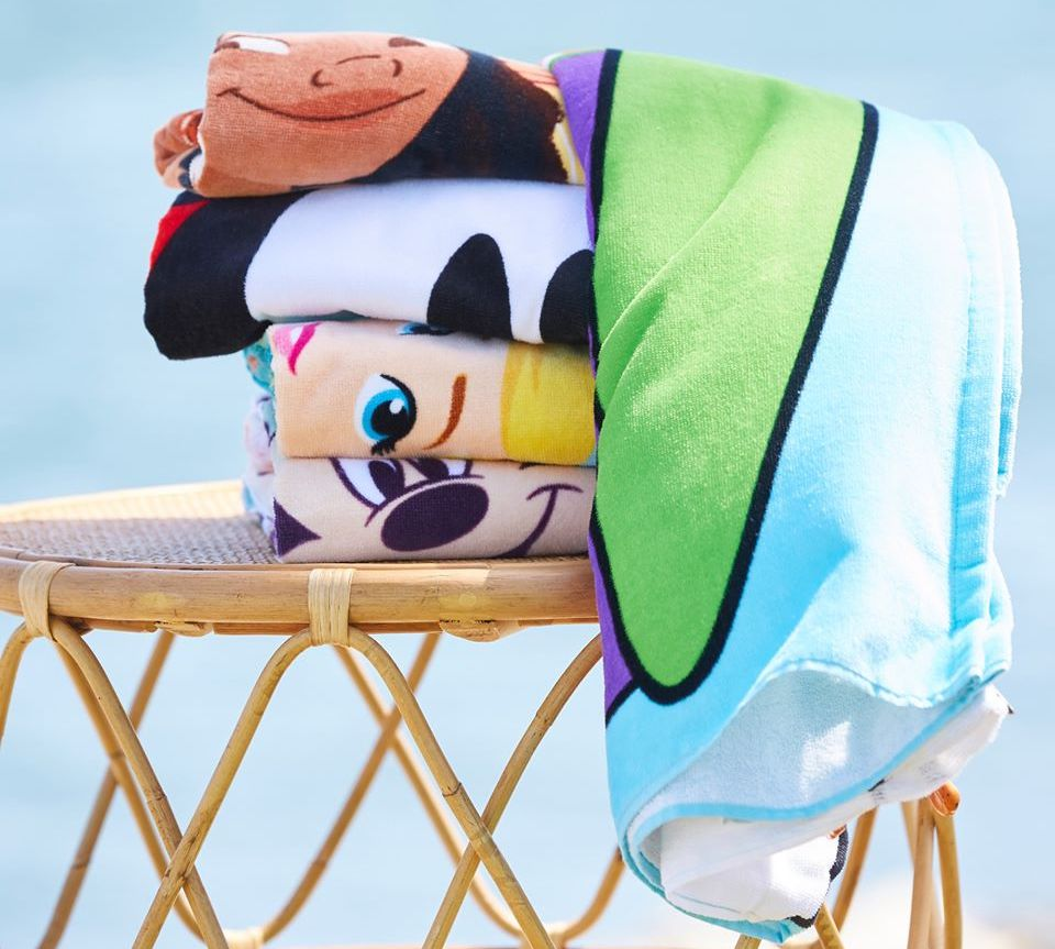 stack of beach towels on a table