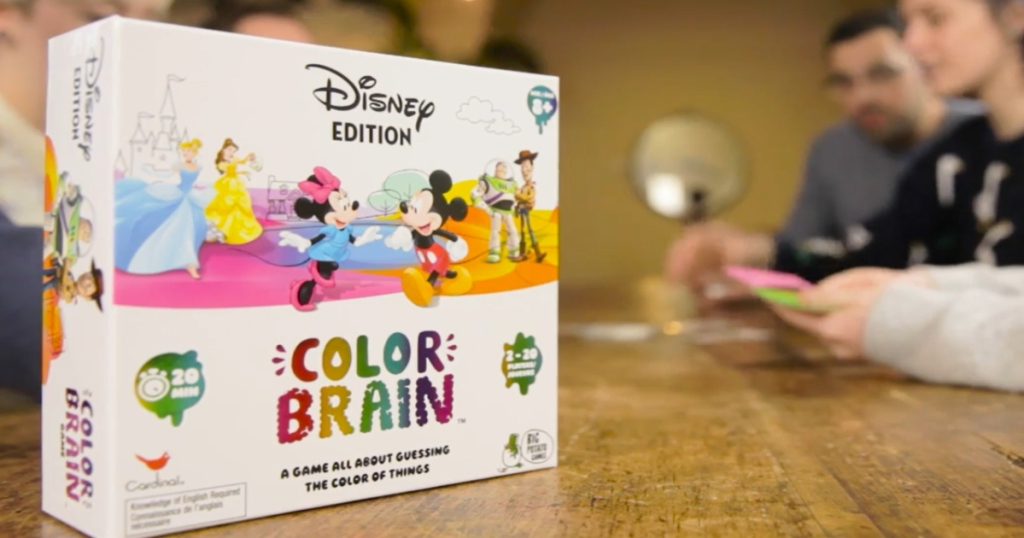 Disney Color Brain Game box on a table with kids at the table playing the game