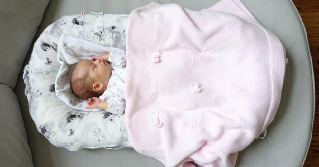 baby in baby sleeper