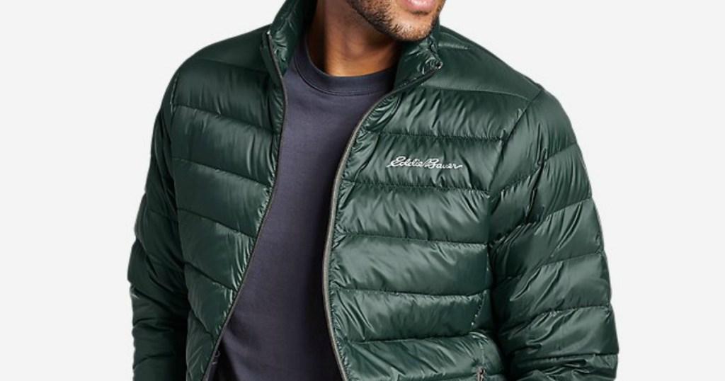 man wearing a green jacket