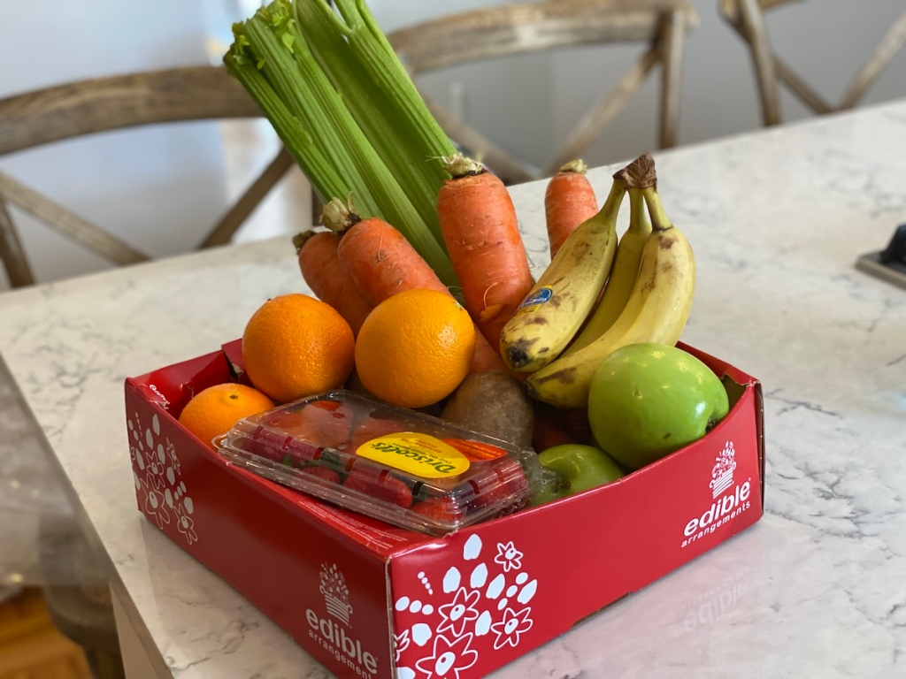box with fruit and vegetables in it