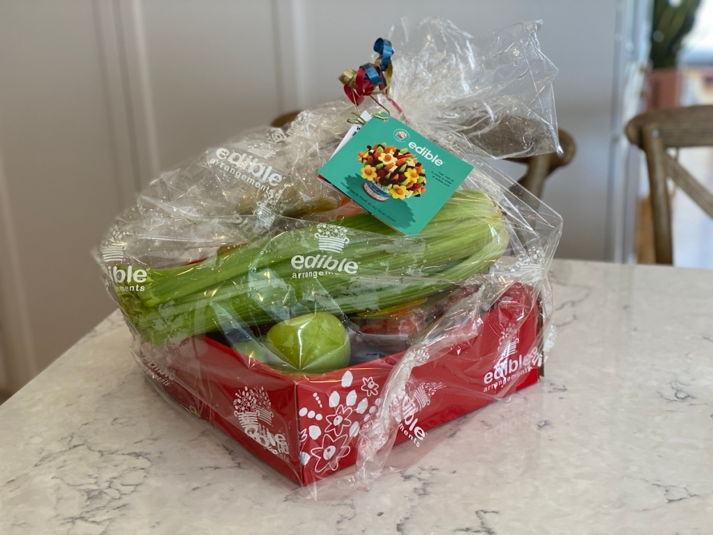 bundle of produce in a box wrapped in plastic