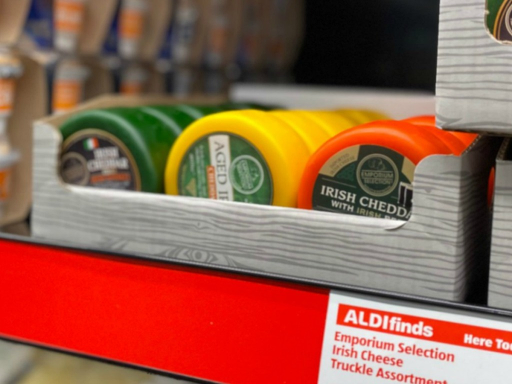 In store display of a variety of Irish cheeses in rows in a box